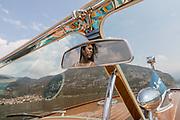 ITALY, Franciacorta area, Iseo,  Bellini Nautica . Martina Belini drving a Riva Motorboatl