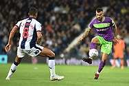 Bristol City midfielder Marlon Pack (21) controls under pressure from West Bromwich Albion midfielder Jake Livermore (8) during the EFL Sky Bet Championship match between West Bromwich Albion and Bristol City at The Hawthorns, West Bromwich, England on 18 September 2018.