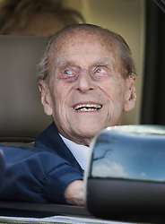 © Licensed to London News Pictures. 11/05/2018. Windsor, UK. The Duke of Edinburgh smiles as he drives himself around the 75th Royal Windsor Horse Show . This is the first time the Duke has been seen since his hip operation last month. The five day event takes place in the grounds of Windsor Castle. Photo credit: Peter Macdiarmid/LNP