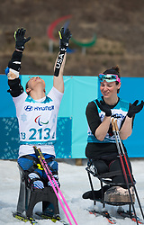 March 17, 2018 - Pyeongchang, South Korea - Oksana Masters of the US celebrates her gold medal finish in the Cross Country 5km sitting event Saturday, March 17, 2018 at the Alpensia Biathlon Center at the Pyeongchang Winter Paralympic Games. Photo by Mark Reis (Credit Image: © Mark Reis via ZUMA Wire)