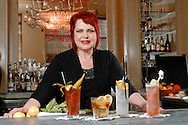 Photograph of bartender Lu Brow poses at the Swizzle Stick Bar at Cafe Adelaide in New Orleans, LA.