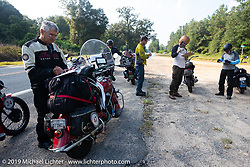 Kerry Patchett doing the daily quiz during the Cross Country Chase motorcycle endurance run from Sault Sainte Marie, MI to Key West, FL. (for vintage bikes from 1930-1948). Stage-7 covered 249 miles from Macon, GA to Tallahassee, FL USA. Thursday, September 12, 2019. Photography ©2019 Michael Lichter.