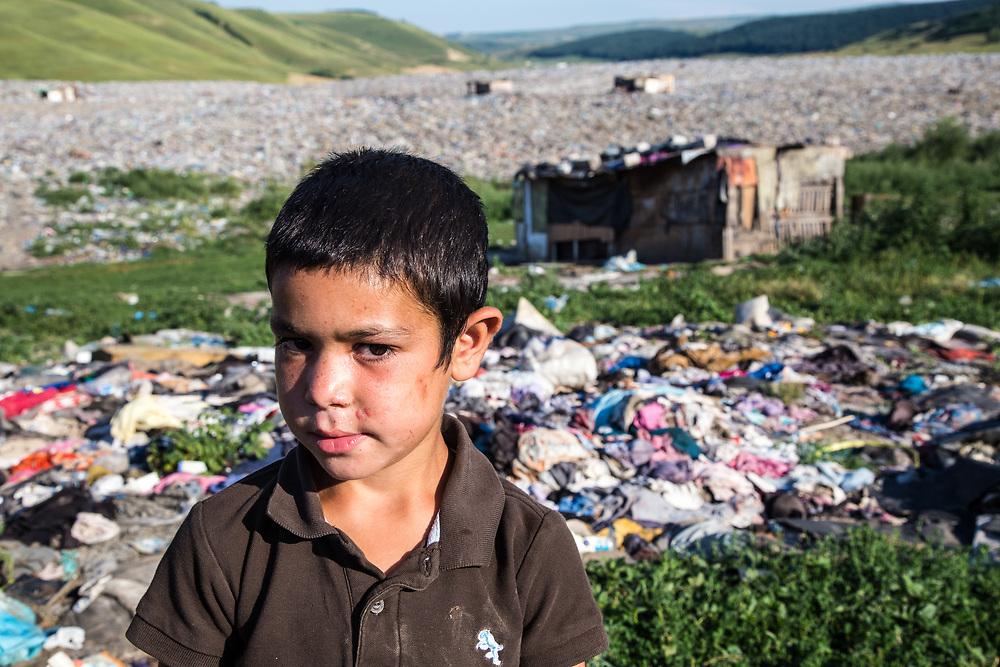 A boy plays outside his home in a slum in the middle of the Pata Rat garbage dump.                                                               © Daniel Barreto Mezzano