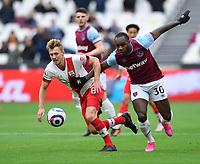 Football - 2020 / 2021 Premier League - Final Round - West ham United vs Southampton - London Stadium<br /> <br /> West Ham United's Michail Antonio battles for possession with Southampton's James Ward-Prowse.<br /> <br /> COLORSPORT/ASHLEY WESTERN