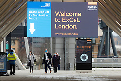 © Licensed to London News Pictures. 11/01/2021. London, UK.People arrive at the Excel Centre Nightingale Hospital to receive a Covid-19 vaccination jab. The hub is one of a few hubs around the Uk to administer mass vaccination jabs. Photo credit: Ray Tang/LNP