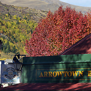 Autumn in Arrowtown main street..Arrowtown is the much visited, historic, 4-season, southern hemisphere holiday destination, located only 20 minutes drive from Queenstown, South Island, New Zealand..Arrowtown is a former gold-mining town built on the banks of the Arrow River, once a rich source of gold in the 1860's and now a sophisticated, multi-cultural town catering visitors from around the globe. Arrowtown offers an ambiance with its shops, restaurants, cafes, offices and galleries located within a tight precinct.  5th April 2011.  Photo Tim Clayton.