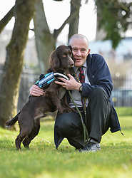 Ex army veteran Tommy Masters from Aboyne can't hide his delight after picking up his new companion dog Antis, a 10 month old spaniel, in Glasgow today. Antis was provided by Scottish-based charity Bravehound, which provides companion and assistance dogs to military veterans throughout the UK.<br /> <br /> © Dave Johnston / EEm
