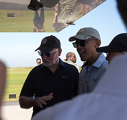 Former US president Barack Obama with Sir Tom Hunter, at the kiosk at the 9th hole. playing golf at St Andrews.