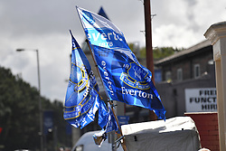 Everton flags on sale before the Premier League match at Goodison Park, Liverpool.