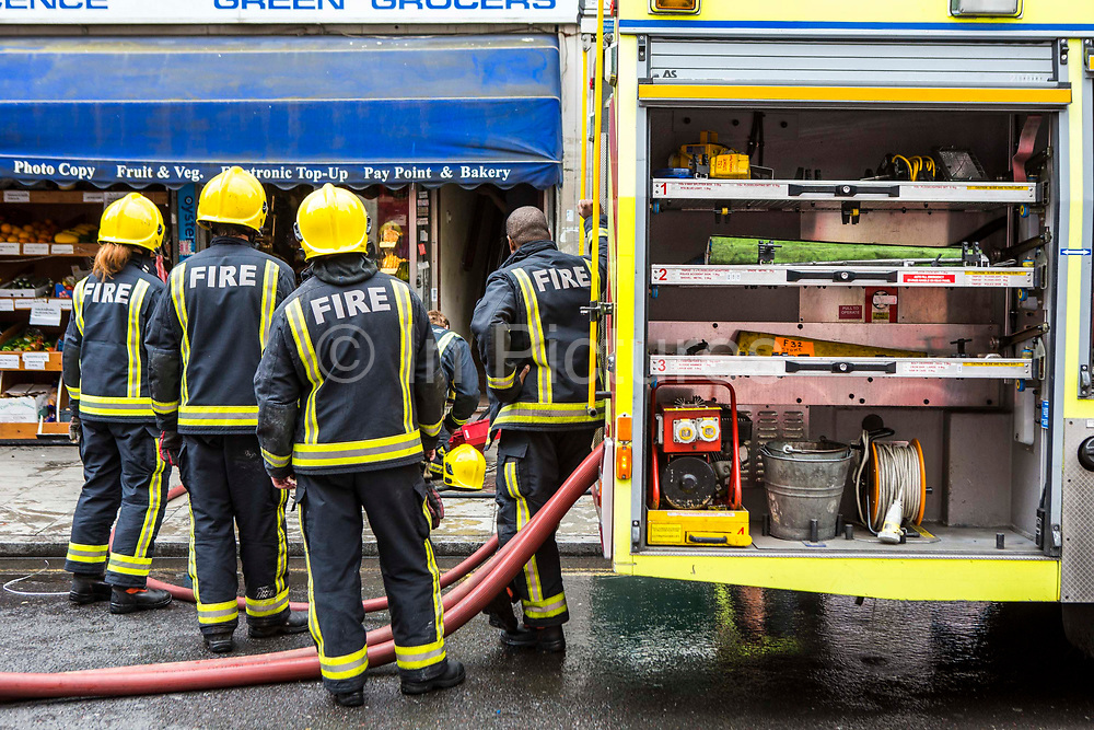 Firefighters from the London Fire Brigade respond to an emergency on Church Street, Stoke Newington, London.  They have been called out due to an explosion in the basement of a shop.  The London Fire Brigade is the 4th largest fire-service in the world.