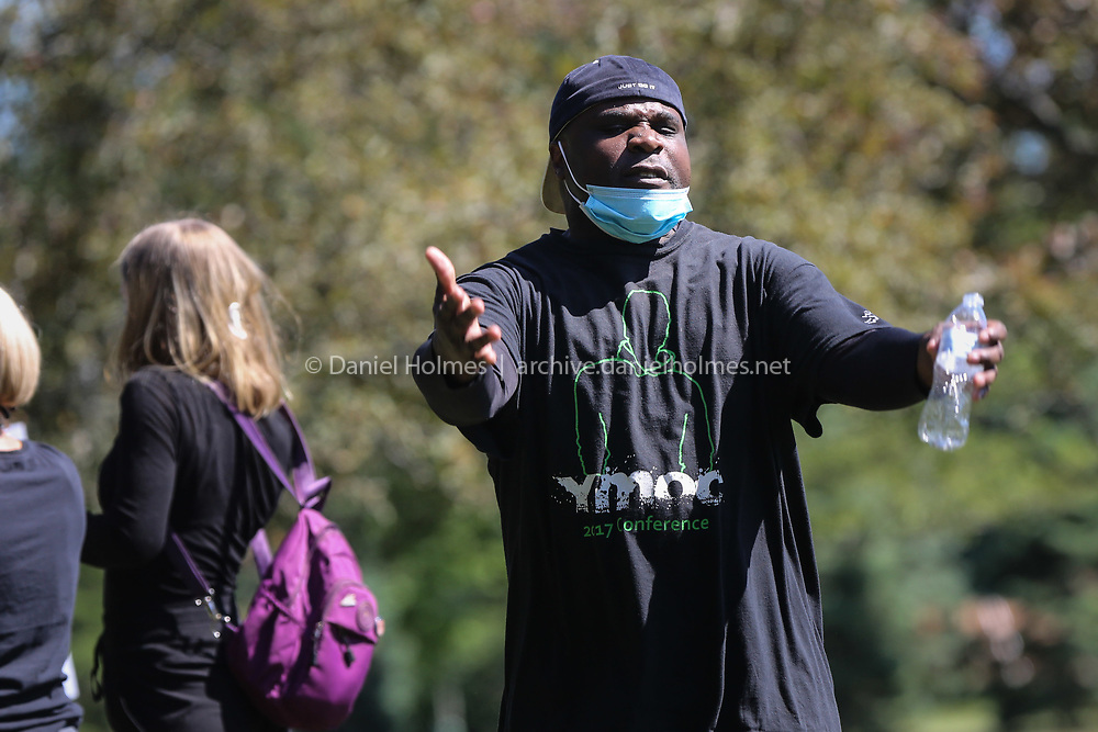 (6/14/20, FRAMINGHAM, MA) Rick Utaegbulam, of Framingham, pumps up the crowd during a Black Lives Matter event at Cushing Memorial Park in Framingham on Sunday. [Daily News and Wicked Local Photo/Dan Holmes]