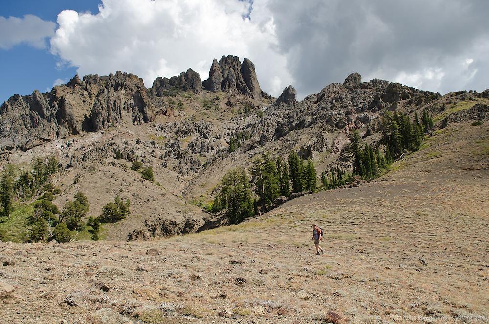 Hiker crossing open sagebrush below mountains, Sierra Nevada, Toiyabe National Forest, California