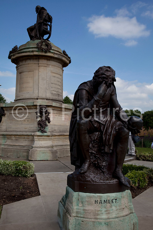 Statue of William Shakespeare and in the foreground, Hamlet in the main park in Stratford upon Avon, a small market town in the county of Warwickshire in central England. The town is a popular tourist destination owing to its status as birthplace of the playwright and poet William Shakespeare, receiving about three million visitors a year from all over the world.
