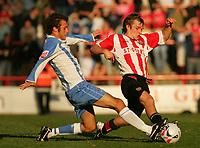 Photo: Frances Leader.<br />Brentford v Swindon Town. Coca Cola League 1.<br />15/10/2005.<br /><br />Brentford's Jay Tabb is tackled by Swindons Neale McDermott.