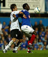 Fotball<br /> England<br /> Foto: SBI/Digitalsport<br /> NORWAY ONLY<br /> <br /> Portsmouth v Fulham<br /> <br /> Barclays Premiership. 30/08/2004<br /> <br /> Aiyegbeni Yakubu of Portsmouth goes up for an aerial ball with Carlos Bocanegra of Fulham