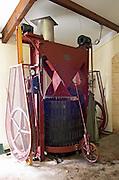 Old vertical basket press. Chateau la Grace Dieu les Menuts, Saint Emilion, Bordeaux, France
