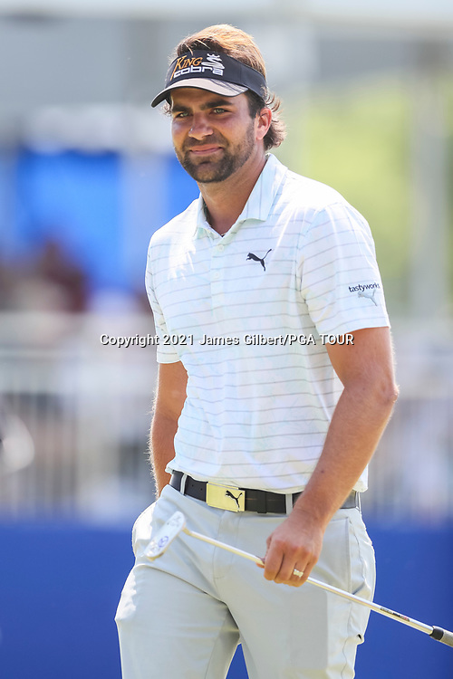 WICHITA, KS - JUNE 20: Curtis Thompson reacts after sinking his putt on the 17th green during the final round of the Wichita Open Benefitting KU Wichita Pediatrics at Crestview Country Club on June 20, 2021 in Wichita, Kansas. (Photo by James Gilbert/PGA TOUR via Getty Images)
