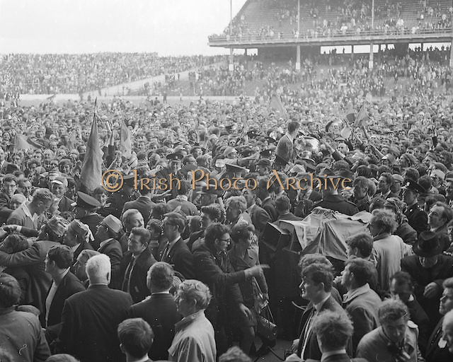 Kerry captain J Culloty brandishes the Sam Maguire Cup as he and his team are chaired through the milling crowds at Croke Park after the All Ireland Senior Gaelic Football Final Kerry v Offaly in Croke Park on 28th September 1969. Kerry 0-10 Offaly 0-7.