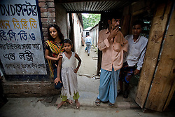 Nodi,14, left, and cousin Suma, 8, are seen at brothel in Tangail, Bangladesh. Nodi run away from home after falling in love with a Hindu boy and ended up in the brothel with her sister. Suma's mother is a sex worker.