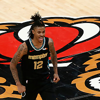 MEMPHIS, TN - MAY 10: Ja Morant (12) of the Memphis Grizzlies celebrates during a game at the FedExForum on May 10, 2021 in Memphis, TN. NOTE TO USER: User expressly acknowledges and agrees that, by downloading and or using this photograph, User is consenting to the terms and conditions of the Getty Images License Agreement. Mandatory Credit: 2021 NBAE (Photo by Chris Elise/NBAE via Getty Images)