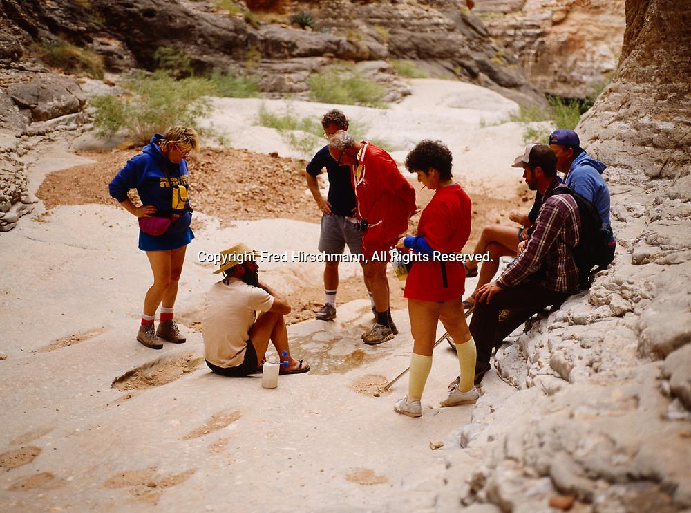 Grand Canyon Dories boatman Kenton Grua leads geology discusson next to fossils in Nautiloid Canyon, tributary to Marble Canyon, Grand Canyon National Park, Arizona.