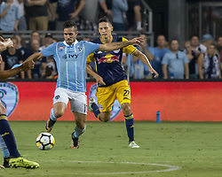 September 20, 2017 - Kansas City, Kansas, U.S - Sporting KC midfielder Benny Feilhaber #10 (l) is on defense against midfielder NY Red Bulls Sean Davis #27 (r) during the second half of the game. Sporting KC will win the 2017 Lamar Hunt Open Cup championship with a score of 2-1 over the New York Red Bulls. (Credit Image: © Serena S.Y. Hsu via ZUMA Wire)