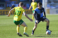 Wycombe Wanderers forward Anis Mehmeti (33)  battles for possession with Norwich City midfielder (on loan from Tottenham Hotspur) Oliver Skipp (20) during the EFL Sky Bet Championship match between Wycombe Wanderers and Norwich City at Adams Park, High Wycombe, England on 28 February 2021.
