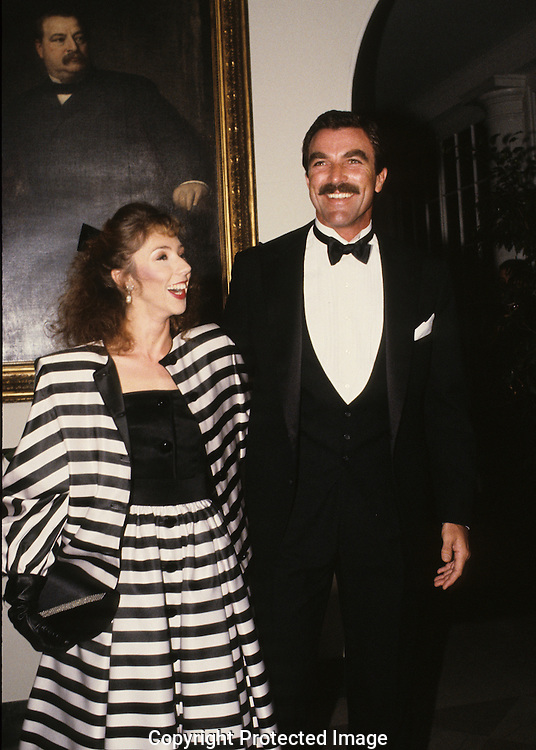 Tom Selleck and Julie Mack arrive at a White House State Dinner for Prince Charles and Lady Diana ..Photograph by Dennis Brack bb 27