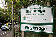 A sign welcoming visitors to the Borough of Elmbridge is pictured on 16 October 2020 in Weybridge, United Kingdom. The Government has announced that the Borough of Elmbridge, which contains the towns of Weybridge, Esher, Cobham, Walton-on-Thames and Molesey, will move into Tier 2 of the Government's new three-tier Local COVID Alert Level system for England with effect from 00.01 on Saturday 17th October, designating it an area of 'High' risk following a significant rise in the number of COVID-19 cases.
