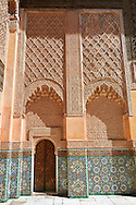 Berber arabesque Morcabe plasterwork and Zellige tiles of the 14th century Ben Youssef Madersa (Islamic college) re-constructed by the Saadian Sultan Abdallah al-Ghalib in 1564 as the largest and most prestigious Medersa in Morocco. Marrakesh, Morroco .<br /> <br /> Visit our MOROCCO HISTORIC PLAXES PHOTO COLLECTIONS for more   photos  to download or buy as prints https://funkystock.photoshelter.com/gallery-collection/Morocco-Pictures-Photos-and-Images/C0000ds6t1_cvhPo<br /> .<br /> <br /> Visit our ISLAMIC HISTORICAL PLACES PHOTO COLLECTIONS for more photos to download or buy as wall art prints https://funkystock.photoshelter.com/gallery-collection/Islam-Islamic-Historic-Places-Architecture-Pictures-Images-of/C0000n7SGOHt9XWI