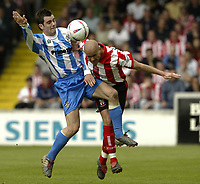 Photo Aidan Ellis, Digitalsport<br /> NORWAY ONLY<br /> <br /> Lincoln City v Huddersfield Town.<br /> Third Divison Play Off Semi Final 1st leg.<br /> 15/05/2004.<br /> Huddersfield's Andy Holdsworth and lincoln's Simon Weaver