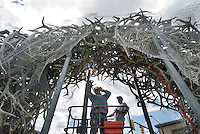 NEWS&GUIDE PHOTO / BRADLY J. BONER.Karrie Fredrickson welds a piece of the support structure under the southwest antler arch Tuesday at the town square. Crews hoped to move the arch in one piece early Wednesday morning to its new home at the Best Western on Broadway.