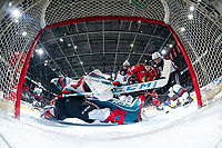 KELOWNA, BC - FEBRUARY 7: Cole Schwebius #31 makes a second period save as Jackson DeSouza #10 and Dylan Wightman #28 of the Kelowna Rockets checks Johnny Ludvig #15 of the Portland Winterhawks at Prospera Place on February 7, 2020 in Kelowna, Canada. (Photo by Marissa Baecker/Shoot the Breeze)