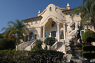 A stone lion and grand staircase lead to this three-story lake front mansion, formerly owned by professional golfer Payne Stewart until his death in a plane accident, in Orlando, Florida.  After his death, the home was sold to former Orlando Magic basketball player Penny Hardaway.  It has since been sold to another buyer.