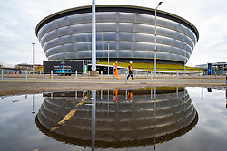 Glasgow, Scotland, UK. 3 April, 2020. Exterior view of workers walking past SSE hydro  during building of temporary  NHS Louisa Jordan field hospital at the Scottish Events Campus (SEC) in Glasgow.  Iain Masterton/Alamy Live News