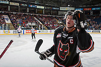 KELOWNA, CANADA - FEBRUARY 1: Micheal Zipp #4 of the Calgary Hitmen skates to the bench to celebrate a first period goal against the Kelowna Rockets on February 1, 2017 at Prospera Place in Kelowna, British Columbia, Canada.  (Photo by Marissa Baecker/Shoot the Breeze)  *** Local Caption ***