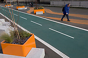 A local lady walks alongside a new cycling path, a regenerated landscape created outside Croydon College and Fairfield Hall, on 20th January 2020, in Croydon, London, England.