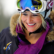 US Snowboarding Team member Gretchen Bleiler hikes to the top of the half pipe during training at the 2009 LG Snowboard FIS World Cup at Cypress Mountain, British Columbia, on February 16th, 2009.