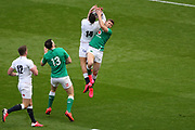 Jonny May of England catches the ball before Jordan Larmour of Ireland during the Six Nations international rugby union match between England and Ireland at Twickenham stadium, Sunday, Feb. 23, 2020, in London, United Kingdom.  England won the match 24-12. (Mitchell Gunn/ESPA-Images-Image of Sport)