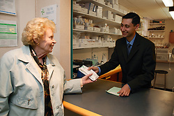 Outpatient collecting prescription from Pharmacy,