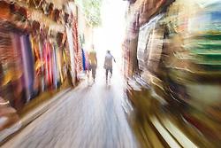 Abstract of people walking through alleys, Fes al Bali medina, Fes, Morocco