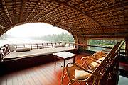 The top deck lounge on a houseboat barge in the Kerala Backwaters, near Alappuzha, India
