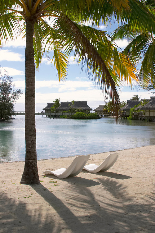 A lagoon with beach and chairs, Beachcomber International Hotel, Moorea, French Polynesia