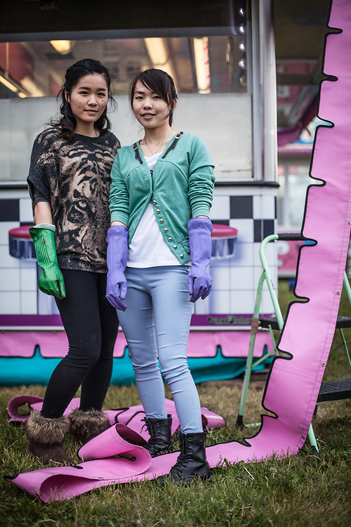 Chinese summer workers, Danny Chen and Joky Wu assist with the set up of a food booth in preparation for the Fourth of July celebration on the Delaney Park Strip, Anchorage