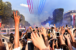 The Patrouille de France (aerobatic demonstration unit of the French Air Force) jets perform as they trail smoke in the colours of the national flag while they fly over the Champs Elysee as supporters welcome players of the French national football team after they won the Russia 2018 World Cup final football match on July 16, 2018 in Paris, France. Photo by Alain Apaydin/ABACAPRESS.COM