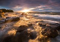Dramatic sunset and crashing waves on Lake Champlain near Burlington, Vermont