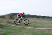 Mountain Bikers at a dirt track event panned photograph