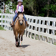 I was very lucky to get invited to join Natalie for a day while she was at her summer horse camp, where she learned to ride and take care of the horses.