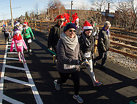 "Coni and Casi Dwinal head out from the start for The Downtown Gym's ""Santa Shuffle"" Sunday morning along Phase II of the Wow Trail starting at Pitman's Freight Room.  (Karen Bobotas/for the Laconia Daily Sun)"