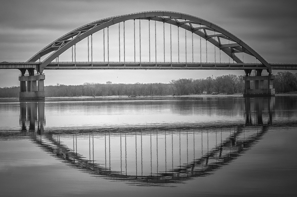 This beautiful reflection shot was taken of this brilliant blue bridge that strattles the Mississippi River.